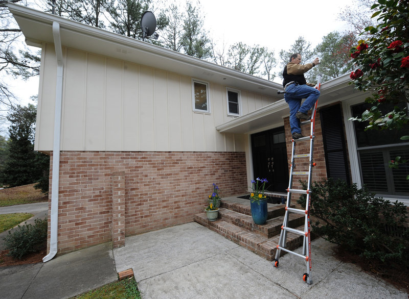 A home inspector checks the roof of a house being sold in Dunwoody, Ga., recently. The Atlanta area saw home prices increase by more than 30 percent in the first quarter from a year earlier.