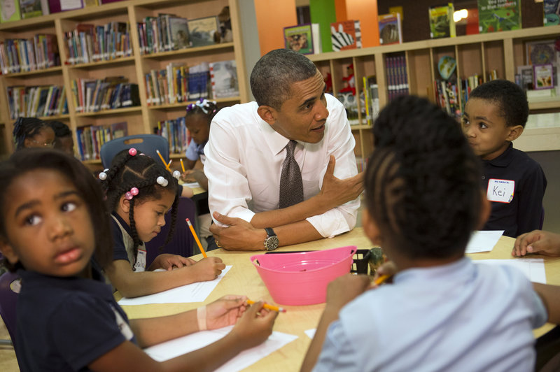 """President Obama talks to a class of pre-kindergarten schoolchildren at Moravia Park Elementary School in Baltimore, Md., on Friday during the his second """"Middle Class Jobs and Opportunity Tour."""""""
