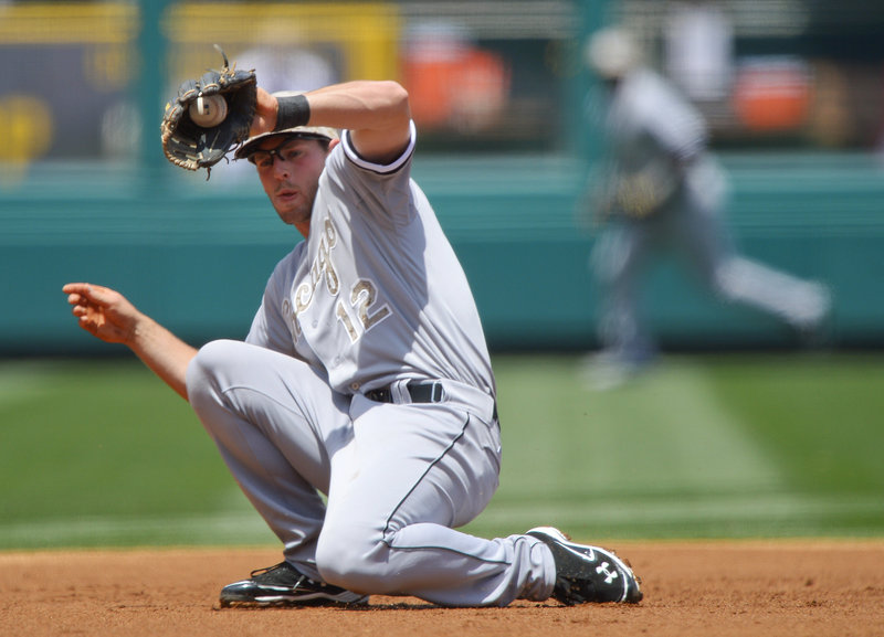 Chicago White Sox third baseman Conor Gillaspie snags a grounder hit by Albert Pujols to start a double play in a 12-9 loss to the Angels at Anaheim on Saturday.