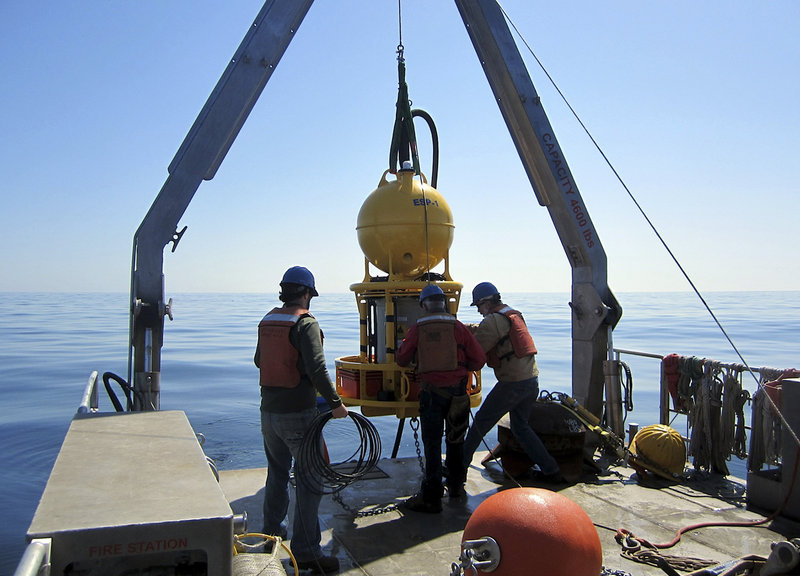 A robotic device is deployed April 28 in the ocean off southern Maine to collect and transmit data about the toxin-producing algae blooms known as red tide.