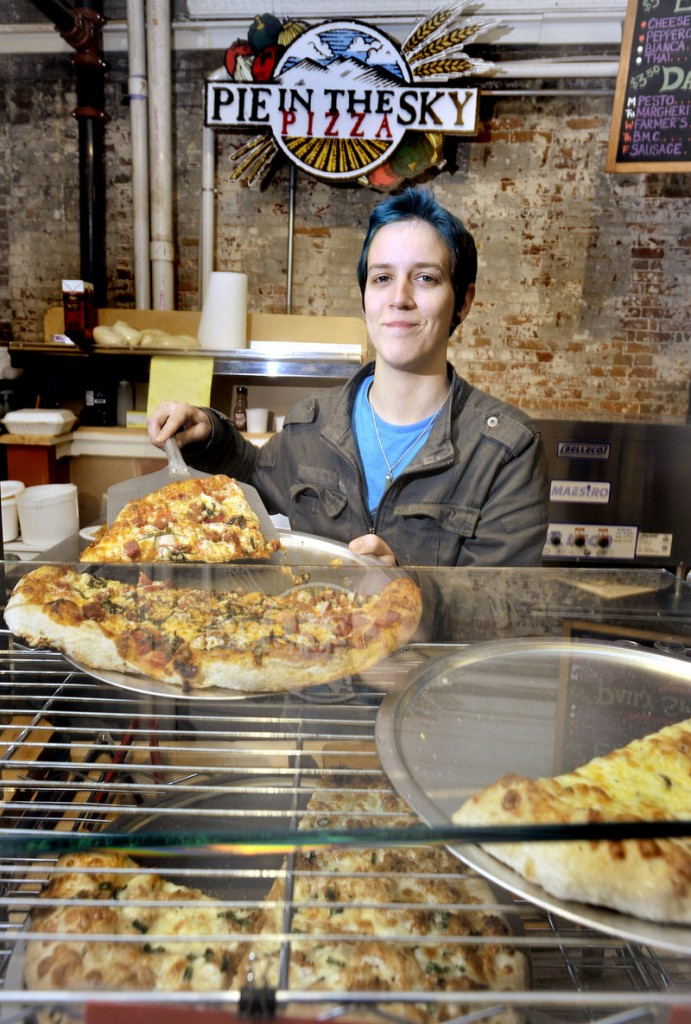 Veronica Smith readies a slice of pizza at Pie in the Sky Pizza at the Public Market building in Portland's Monument Square.