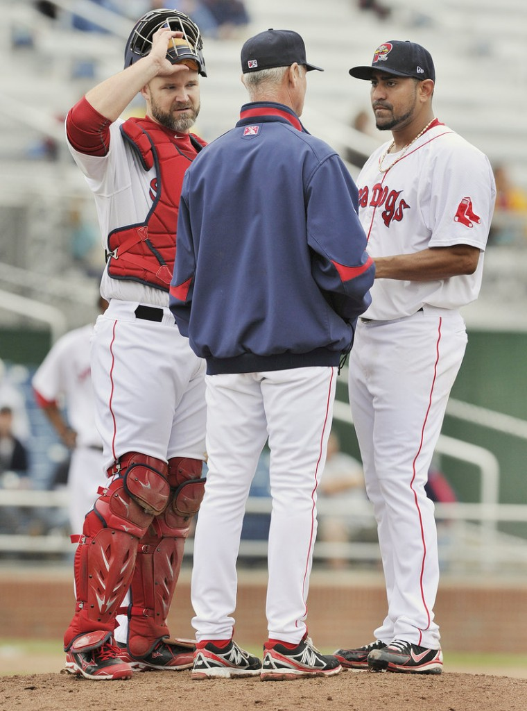 Franklin Morales and catcher David Ross, both in Portland on rehab assignments, listen to Sea Dogs pitching coach Bob Kipper in the fifth inning of an 8-4 victory Thursday at Hadlock Field.