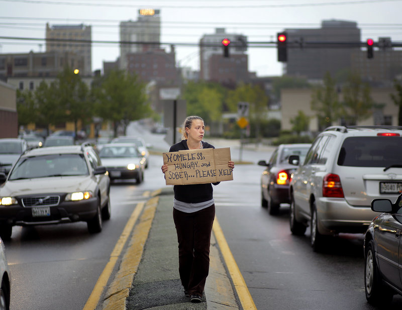 Alison Prior, 29, of Portland, panhandles for change at the corner of Preble Street and Marginal Way on Friday, May 24, 2013. Prior says she panhandles for extra money while she and her boyfriend look for an apartment.