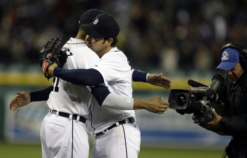 Detroit's Anibal Sanchez, right, gets a congratulatory hug from teammate Victor Martinez after Sanchez nearly threw his second no-hitter of the season, ending up with a one-hit win on Friday.