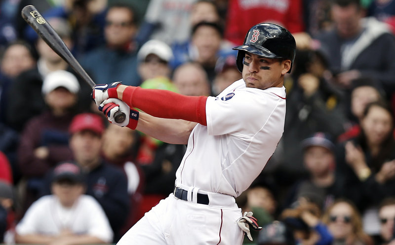 Jacoby Ellsbury follows through on his game-winning two-run double during the ninth inning of Boston's 6-5 win over the Indians on Sunday.