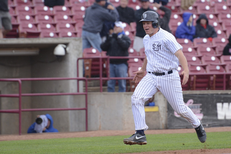 Matt Verrier is ready to touch the plate for USM after hitting a three-run homer in the fourth inning Monday against Wisconsin-Stevens Point in the NCAA Division III baseball championships at Appleton, Wisc.