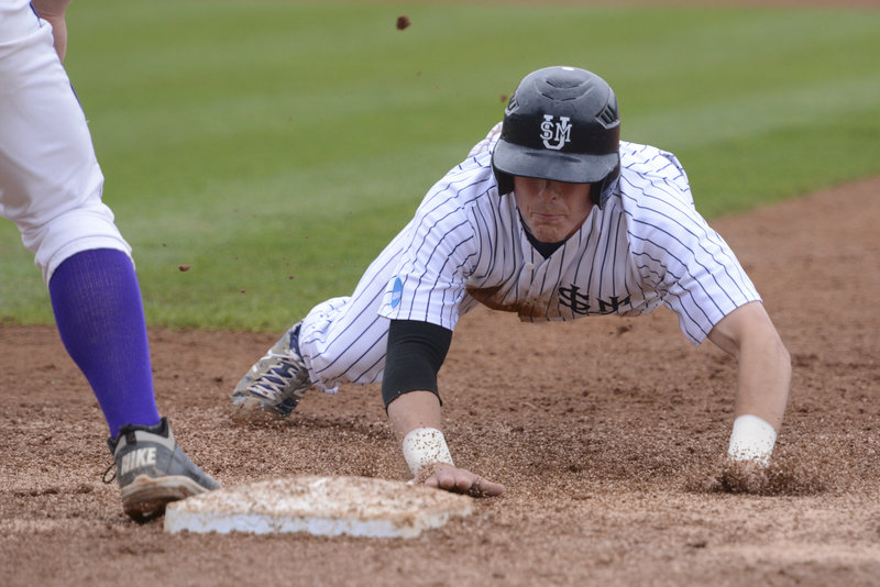 Troy Thibodeau of USM dives back safely to first on a pickoff attempt in Monday's game at the NCAA Division III championships in Appleton, Wisc. USM advanced with an 8-1 win over Wisconsin-Stevens Point.