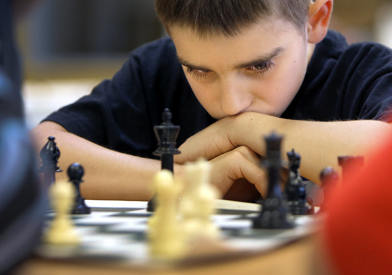 Mick Fennessy, 10, a fourth-grader at East End Community School in Portland, contemplates his next move while competing in the school's inaugural chess meet Wednesday, May 29, 2013.