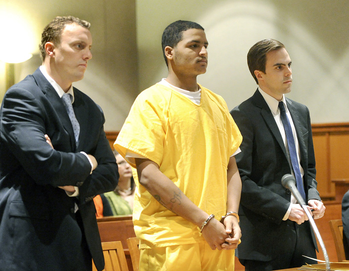 In this April 26, 2013 file photo, Anthony Pratt, 19, is flanked by his attorneys Peter Cyr and Dylan Boyd. Pratt is accused of killing Margarita Fisenko Scott last January in Portland.