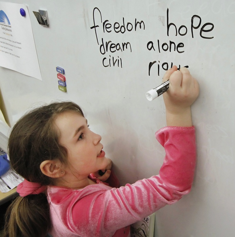 Tianna Currier, a third-grade student at East End Community School in Portland, writes how she feels about Martin Luther King Jr. in this 2011 file photo. East End School has seen a 34 percent rise in combined math and reading test scores in the past two years, as well as improved attendance, since receiving a federal School Improvement Grant