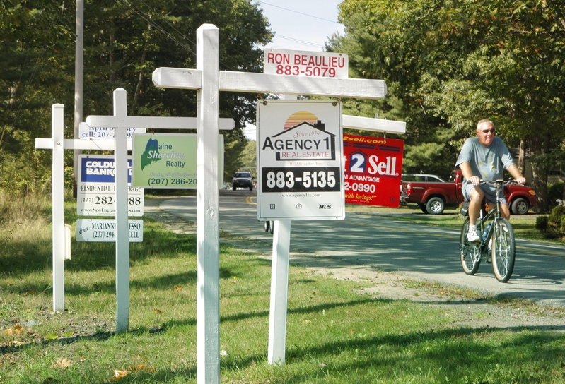 For sale signs dot the lawn outside a condominium complex in Old Orchard Beach in 2010.