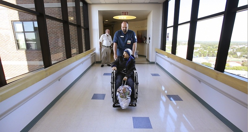 In this September 2012 file photo, a patient is wheeled out of Barbara Bush Children's Hospital at Maine Medical Center in Portland. A state agency will soon decide whether letting Anthem and MaineHealth be Obamacare partners is a good idea.