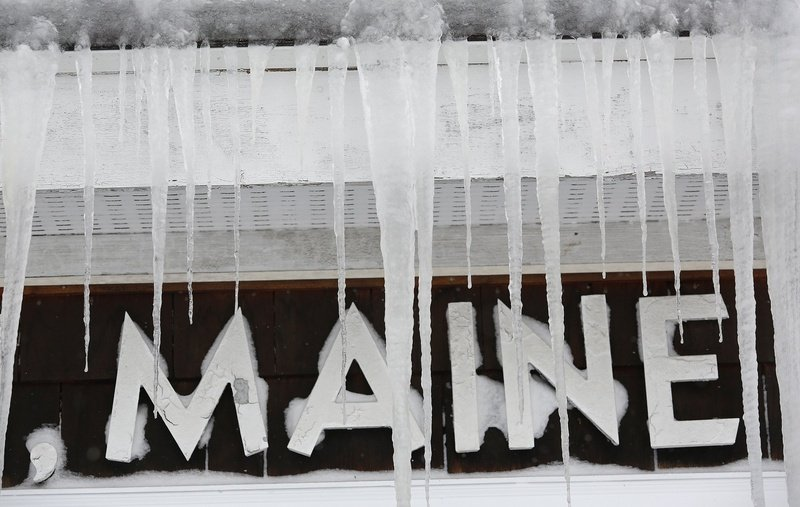 Icicles cover a sign at the Scarborough Post Office on Feb. 9 after a storm buried the area in snow. The federal government is providing $1.5 million in aid to help pay costs associated with the storm.
