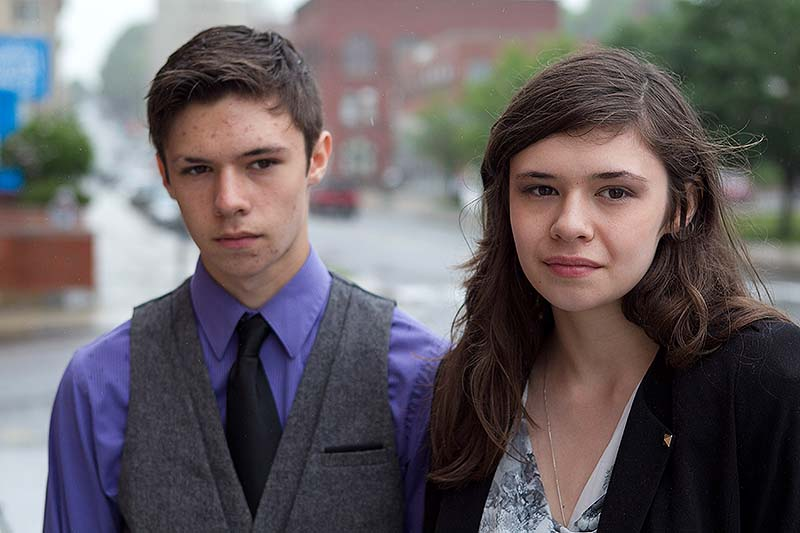 Jonas Maines, left, and his transgender twin sister, Nicole Maines, appear Wednesday outside court in Bangor. Nicole, who was born male but has always considered herself a girl, says the Orono school district discriminated by banning her from the girls' bathroom.