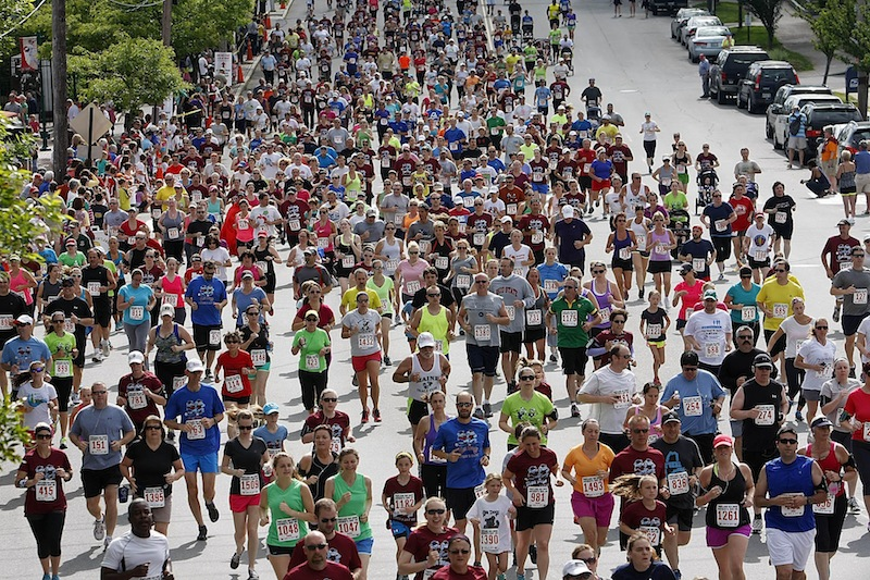 A pack of more than 1,300 runners heads down Park Street in front of Hadlock Field near the start of the Portland Sea Dogs Father's Day 5K.