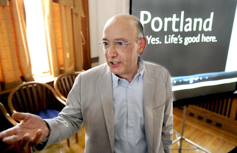 David Puelle of Puelle Design joins other business leaders at the unveiling of Portland's new branding campaign Tuesday. Slogan
