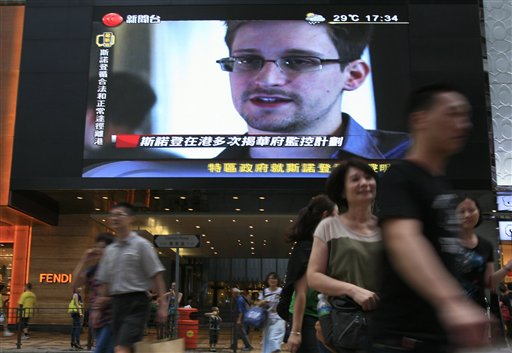 A TV screen shows a news report of Edward Snowden, a former CIA employee who leaked top-secret documents about sweeping U.S. surveillance programs, at a shopping mall in Hong Kong Sunday, June 23, 2013. The U.S. assumes NSA leaker Edward Snowden remains in Russia, and officials are working to have him returned to America to face criminal charges. (AP Photo/Vincent Yu)