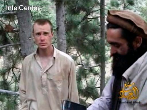 This image provided by IntelCenter shows a frame grab from a video released by the Taliban containing footage of a man believed to be Bowe Bergdahl, left. A Taliban spokesman, Shaheen Suhail, in a telephone interview from the newly opened Taliban offices in Doha, Qatar, said Thursday, that they are ready to hand over Bergdahl for five of their senior operatives being held at the Guantanamo Bay prison.