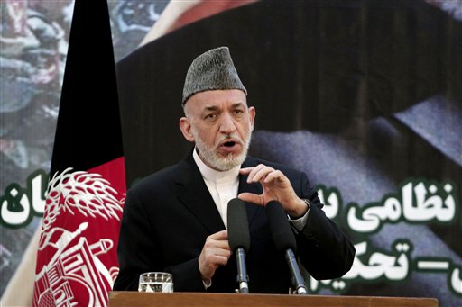 Afghan President Hamid Karzai speaks at a press conference during a ceremony at a military academy on the outskirts of Kabul, Afghanistan, on Tuesday, as Afghan forces take over the lead from the U.S.-led NATO coalition for security nationwide.
