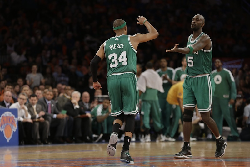 The Boston Celtics are in talks to trade forward Paul Pierce (34) and Celtics center Kevin Garnett (5) to the New Jersey Nets. (AP Photo/Kathy Willens)