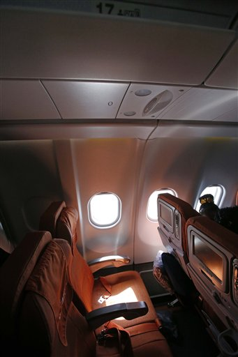 Light shines through a cabin window on seat 17A, the empty seat that an Aeroflot official said was booked in the name of former CIA technician Edward Snowden, on flight SU150 from Moscow to Havana, Cuba, Monday.