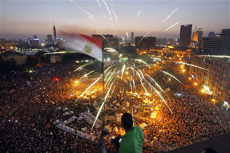 Egyptians gather in Tahrir Square in Cairo in a demonstration against President Mohammed Morsi on Sunday. Hundreds of thousands of Egyptians poured onto the streets in Cairo and across Egypt, launching an all-out push to force Morsi from office on the one-year anniversary of his inauguration.