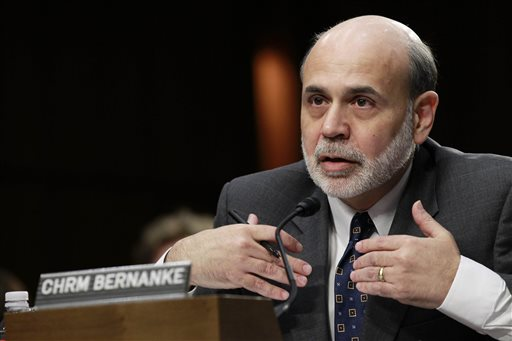 Federal Reserve Board Chairman Ben Bernanke testifies on Capitol Hill ibefore the Senate Budget Committee in this 2012 photo. The financial world looks to Bernanke to clarify the Fed's timetable on economic stimulus.