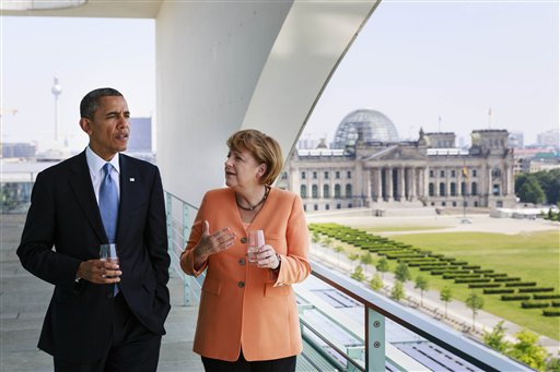 In this photo provided by the German government's press office, German Chancellor Angela Merkel talks to President Barack Obama at the chancellery in Berlin on Wednesday. In the background is the German Parliament building, the Reichstag.
