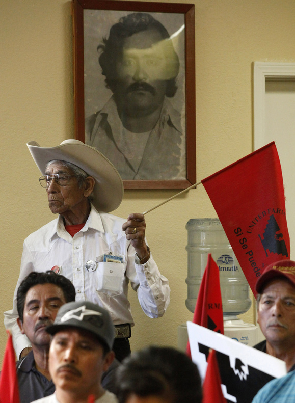 Adan Ramirez stands under a portrait of Rufino Contreras during a meeting at the United Farm Workers office in Salinas, Calif., to discuss the immigration reform bill on Thursday. Contreras was killed during a labor strike in 1979.