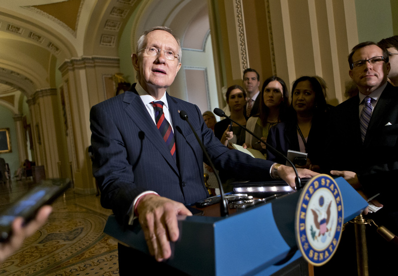 Senate Majority Leader Harry Reid of Nevada updates reporters on the pace of the immigration reform bill following a Democratic strategy session Tuesday on Capitol Hill in Washington.