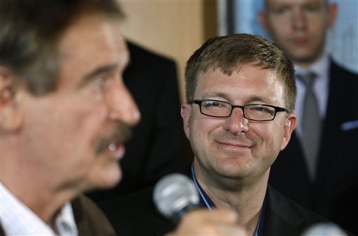 In this May 30, 2013, photo, former Mexican president Vicente Fox, left, speaks as Jamen Shively, CEO of Diego Pellicer, looks on during a news conference in Seattle.