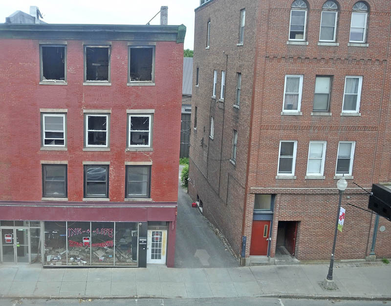 A building damaged by fire in late May on Main Street in downtown Waterville remains unihabitated.