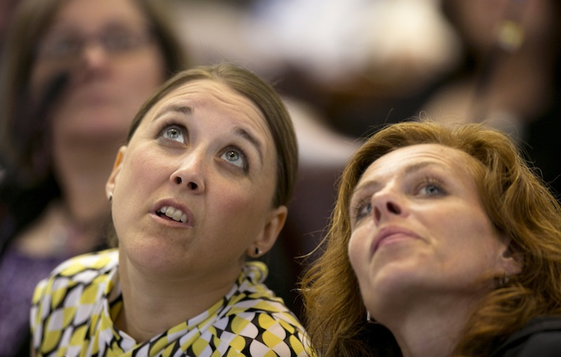 State Reps. Eleanor Espling, R-New Gloucester, left, and Amy Volk, R-Scarborough, look at the tote board during a roll call vote on the state budget during a session Thursday, June 13, 2013, at the State House in Augusta, Maine. Lawmakers are taking up a budget proposal that earned unanimous committee approval and a veto threat from Gov. Paul LePage. (AP Photo/Robert F. Bukaty)