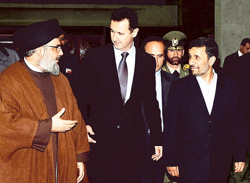 """Hezbollah leader Sheik Hassan Nasrallah, left, speaks with Syrian President Bashar Assad, center, and then-Iranian President Mahmoud Ahmadinejad in Damascus, Syria. Many are saying America should intervene in Syria, but former Sen. Barney Frank disagrees. """"I have not heard or read ... a coherent explanation of what it is they believe America can do to make it better (in Syria),"""" he writes."""