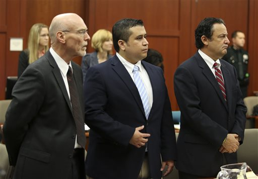 Attorney Don West, left, and jury consultant Robert Hirschhorn, right, stand with George Zimmerman as potential jurors enter the courtroom for Zimmerman's trial in Seminole circuit court in Sanford, Fla., on Thursday.