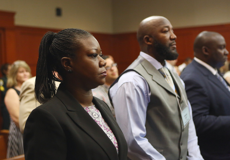 Trayvon Martin's parents, Sybrina Fulton, left, and Tracy Martin, center, attend George Zimmerman's trial in Seminole circuit court in Sanford, Fla., on Thursday. Zimmerman has been charged with second-degree murder for the 2012 shooting death of Trayvon. george-zimmerman-trial-day-14