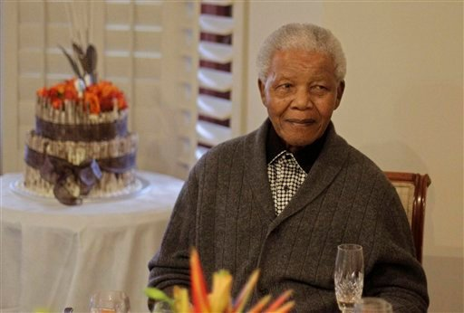 Former South African President Nelson Mandela celebrates his 94th birthday with family in Qunu, South Africa, last year. He was said to be in critical condition Sunday.