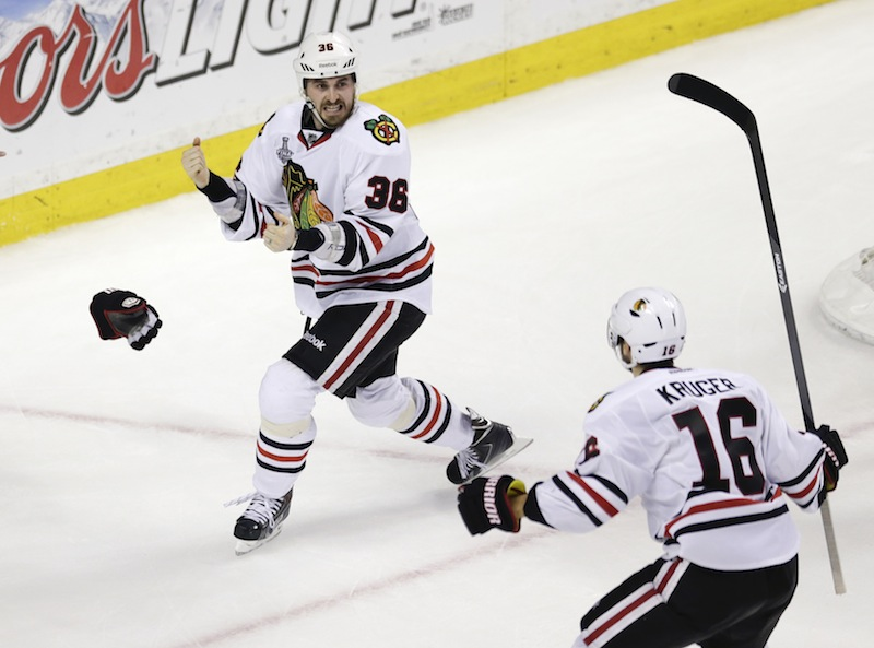 Chicago Blackhawks center Dave Bolland (36) celebrates his game-winning goal against the Boston Bruins with Chicago Blackhawks center Marcus Kruger (16) during the third period in Game 6 of the NHL hockey Stanley Cup Finals, Monday, June 24, 2013, in Boston. The Blackhawks won 3-2. (AP Photo/Charles Krupa) TD Garden