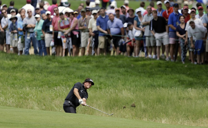 Phil Mickelson hits on the fifth hole during the first round of the U.S. Open golf tournament at Merion Golf Club, Thursday, June 13, 2013, in Ardmore, Pa. (AP Photo/Darron Cummings)