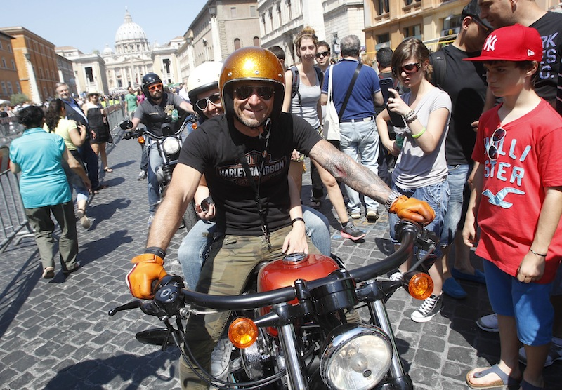 Harley-Davidson riders parade in Via della Conciliazione leading to St. Peter's Square during a Mass celebrated by Pope Francis, at the Vatican, Sunday, June 16, 2013. Pope Francis on Sunday blessed thousands of Harley Davidsons and their riders as the American motorcycle manufacturer celebrated its 110th anniversary with a loud parade and plenty of leather. (AP Photo/Riccardo De Luca)