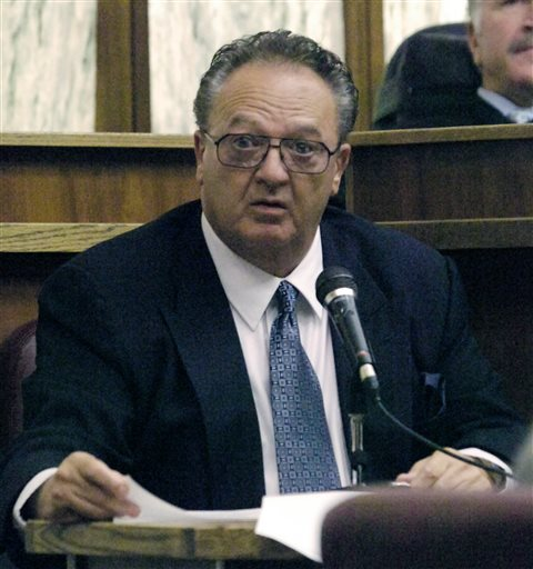 In this Sept. 17, 2008, photo, John Martorano is questioned in a Miami courtroom about his plea agreement in exchange for testifying against former FBI agent John Connolly. Connolly was accused of helping the Boston mob murder Miami gambling executive John Callahan in 1982 at Miami International Airport. Martorano will be on the witness stand Monday to testify at the trial of James
