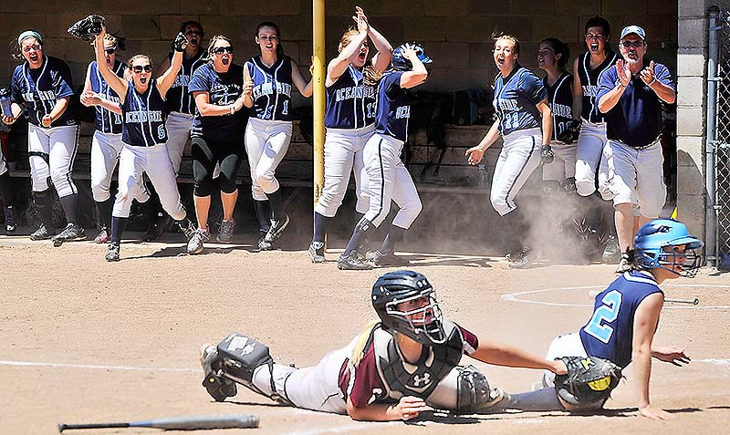 Oceanside players cheer as their first run is scored by Abby Herson to make it 1-1 in the sixth inning Saturday in the Class B state softball final in Standish. Oceanside rallied for an 8-1 win over Greely.