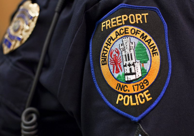 The Freeport Police Department shoulder patch displaying the debunked motto will be phased out, according to Town Manager Peter Joseph.