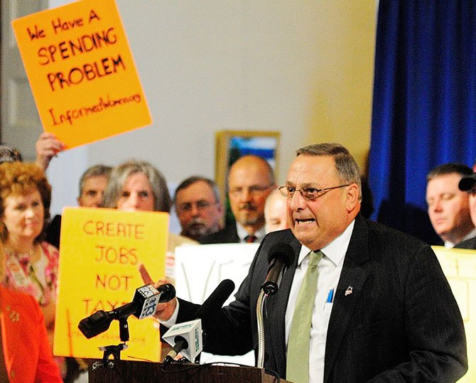 Gov. Paul LePage speaks during a rally on Thursday June 20, 2013 in the Hallo of Flags at the State House in Augusta.