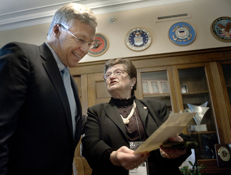 In this November 2011 file photo, U.S. Rep. Michael Michaud, D-Maine, surprises Jan Barrett, of Lewiston, Maine, with a copy of the mention of her father, Lt. Thomas Plourde, in the Congressional Record in his office before the ceremony on Wednesday, Nov. 2, 2011. Michaud is inching closer to joining Maine';s gubernatorial race.