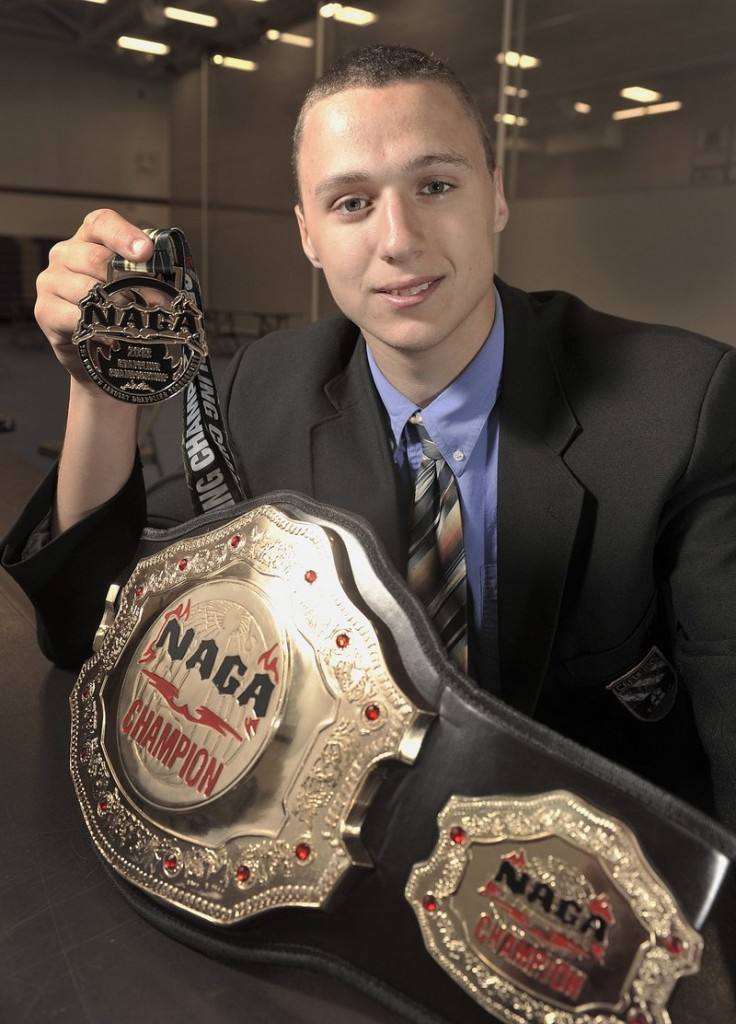 Zordan Holman shows off one of the age-group championship belts he won in April at a Brazilian jiu-jitsu competition in New Jersey.