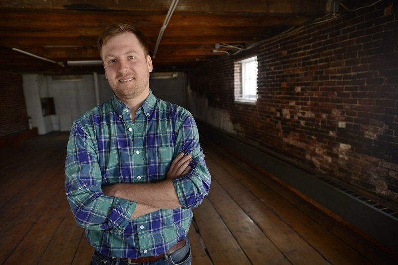 Chef Chris Gould is shown at 414 Fore St. in Portland, where he plans to open a new restaurant. The brick structure was erected in 1828.