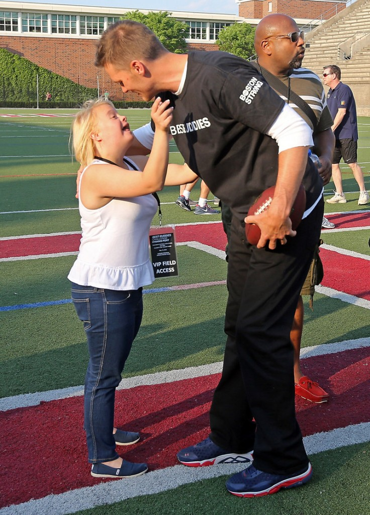 """New England's Tom Brady greets """"Glee"""" cast member Lauren Potter at the Best Buddies charity football game at Harvard on Friday. Patriot Danny Amendola also helped the fundraiser."""