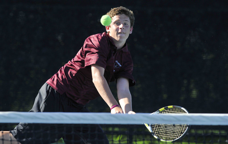 Tom Brent of Gorham lunges to return a shot against Kennebunk's David Behrens during their No. 3 singles match in the Western Class A final Wednesday at Bates College. Brent won 7-6 (5), 6-4, helping Gorham to a 4-1 victory.