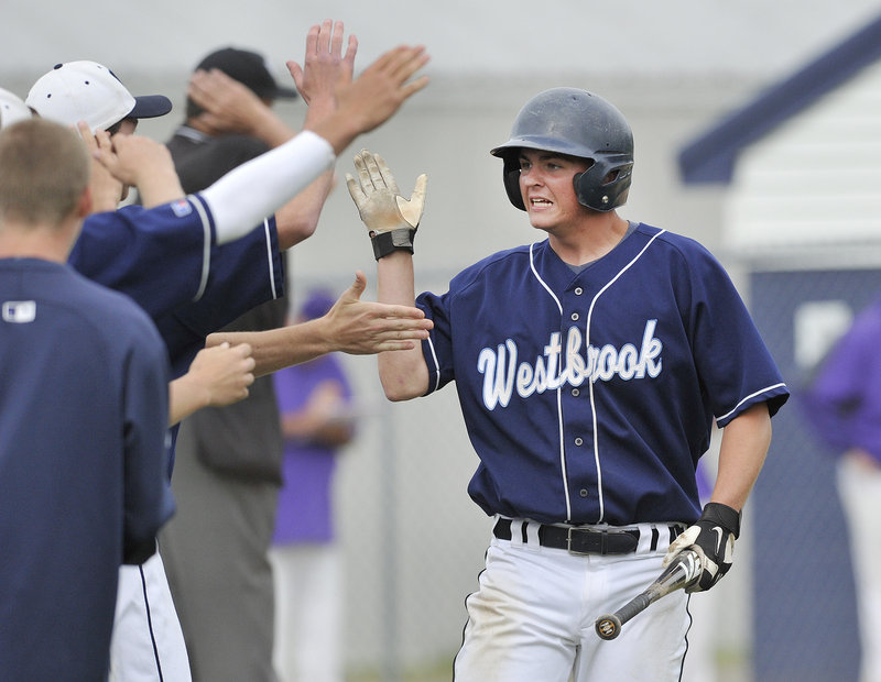 Derek Bouchard is greeted by his Westbrook teammates Thursday after scoring the sixth-inning run that proved the winner in a 3-2 quarterfinal victory against Cheverus.